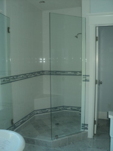 Tile shower and wainscot carrara shower floor and dam glass tile
